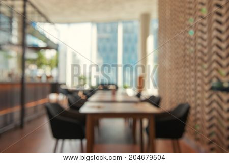 Blurred background - Coffee shop in building blur background with bokeh. Vintage filtered image. Panoramic banner.