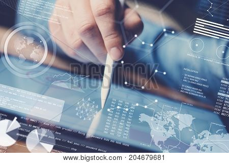 Concept of digital diagram, graph interfaces, virtual display, connections icon.Man using contemporary electronic tablet at office.Blurred background. Horizontal