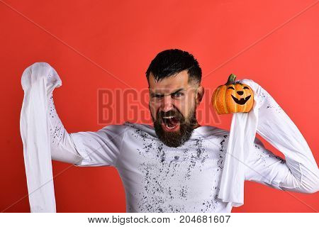 Man With Mad Face Expression On Red Background. Halloween Character
