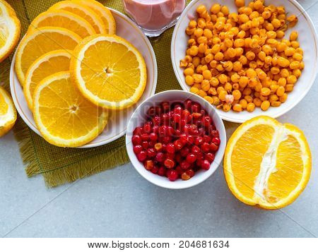 Oranges and berries of cranberry and cranberry on the table. Healthy Eating, Vitamin, Detoxification, Dietary Nutrition, Clean Food Concept