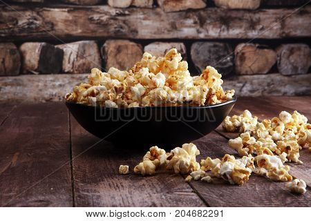 Salt Popcorn Or Sweet Popcorn In Bowl On The Wooden Table