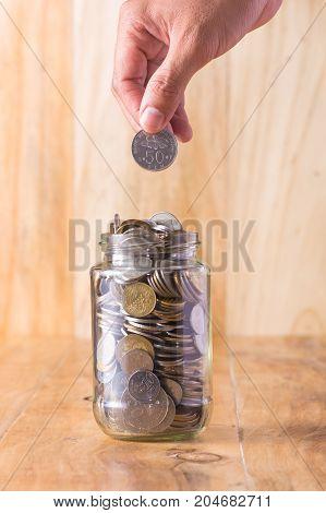 into a glass jar for a savings