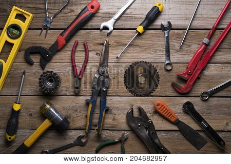 Old tools on wood table background, top view