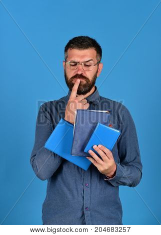 Man With Beard And Books. Notebooks In Blue Color