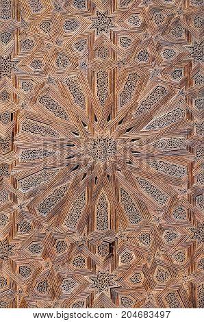 Elaborate star texture pattern on wooden door of mosque in Fez, Morocco, North Africa.