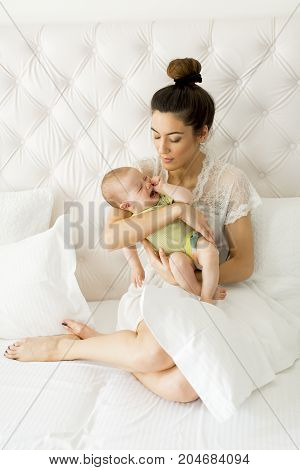 Young Mother Holding Her Litle Crying Daughter