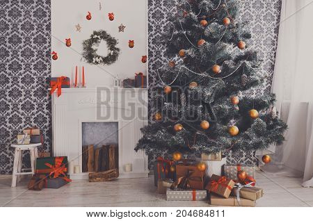 Beautiful decorated room with Christmas tree and fireplace. Winter holiday design and decorations background