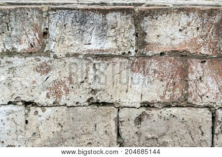 Texture of old brick wall painted with white paint