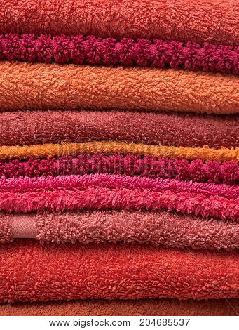 Stack Of Bath Towels In Warm Red Colors