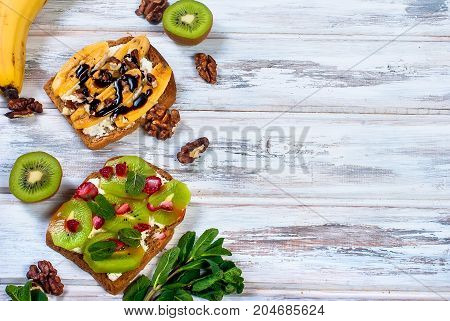 Tasty Sweet Sandwiches With Bananas, Nuts And Chocolate,  On Wooden Table