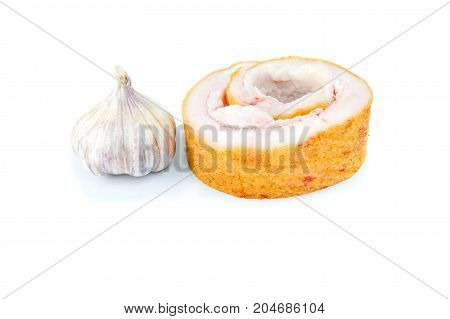 Pork belly and not peeled garlic isolated on a white background.