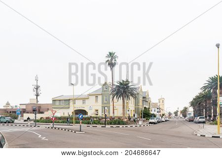 SWAKOPMUND NAMIBIA - JUNE 30 2017: A street scene with historic buildings and cars in Swakopmund in the Namib Desert on the Atlantic Coast of Namibia
