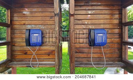 wooden call box with blue telephone. wooden call box with blue telephone.