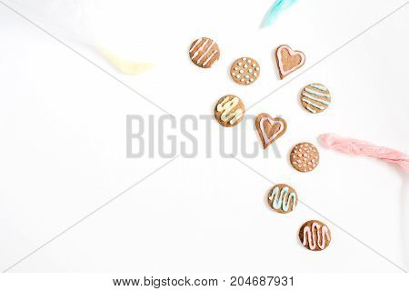 Colorful hand made cookies on white background. Flat lay top view.