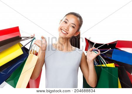 Happy Smiling Attractive Asian Woman With Shopping Bags Isolated