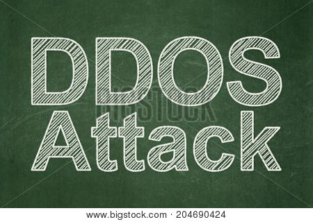 Privacy concept: text DDOS Attack on Green chalkboard background