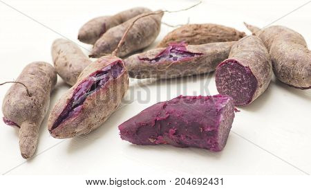 Purple sweet sotato boiled ready to eat and peeled only one isolate on white Macro photo zoom in focus select at center of object around are blur and has copy space.