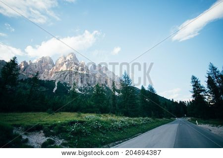 Beautiful sunset over high altitude mountain road next to famous peak in italian dolomites Tre Cime de Lavaredo famous for rocky formations and snow in summer