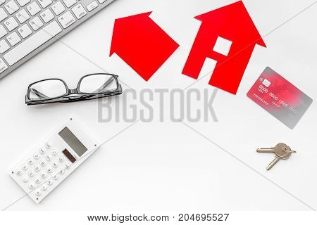 buy house online set with paper figures, keys and credit card on office desk white background top view mock-up