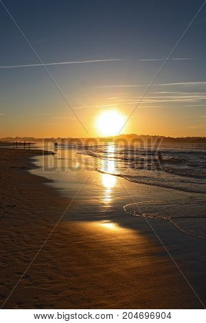 People silhouettes on the beach in sunset time, Spain