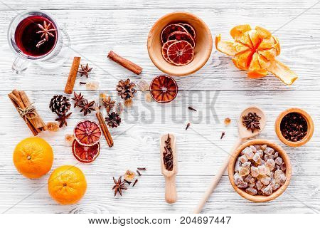 Celebrate new year winter evening with hot drink. Mulled wine or grog ingredients. White desk background top view.