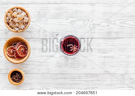 Celebrate new year winter evening with hot drink. Mulled wine or grog ingredients. White desk background top view. Space for text