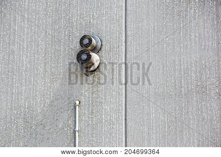 cement wall. minimalism concept. with white air vent hole