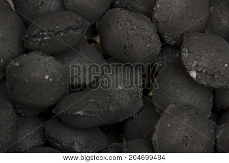 Charcoal Briquettes For Bbq Grill Background Texture Close-up Overhead View
