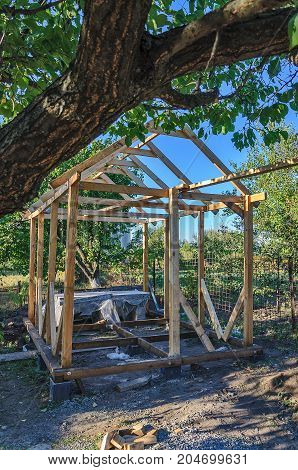 Frame of an unfinished wooden pergola for rest.