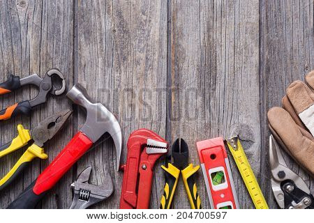 Set of tools on wooden background . Top view copy space