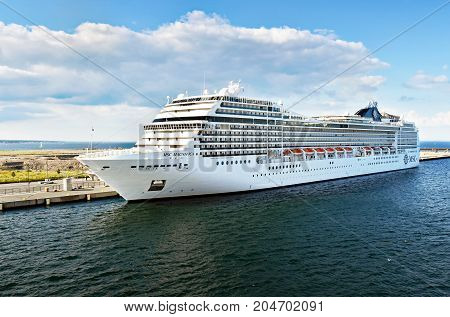 Copenhagen, Denmark - July 15, 2017: The cruise ship MSC Magnifica of MSC Cruises is moored at the Ocean Quay Cruise Terminal in the port of Copenhagen.