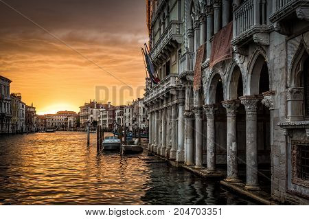 Grand Canal with Ca' d'Oro palace at sunset in Venice, Italy. Ca' d'Oro (Palazzo Santa Sofia) is one of the older palaces in Venice.