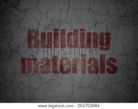Building construction concept: Red Building Materials on grunge textured concrete wall background