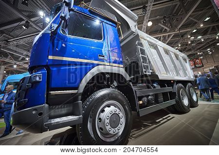 MOSCOW, SEP, 5, 2017: Close up view on Volvo dump truck exhibit on Commercial Transport Exhibition ComTrans-2017. Volvo commercial transport on exhibition stand. Commercial dump trucks cars