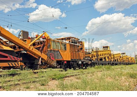 Railway track service car.Crushed stone install construction machine on rails.