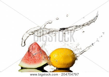 Watermelon With lemon, water Splash isolated on white background.