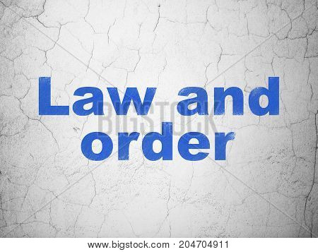 Law concept: Blue Law And Order on textured concrete wall background
