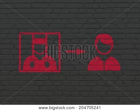 Law concept: Painted red Criminal Freed icon on Black Brick wall background