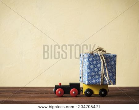 Gift box on toy train. Christmas holiday celebration concept