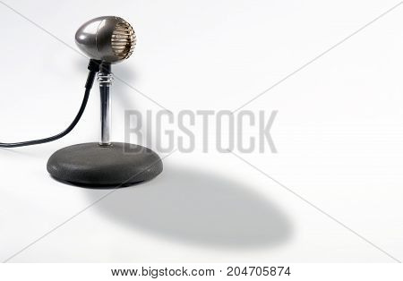 Old style antique microphone with room for your type.