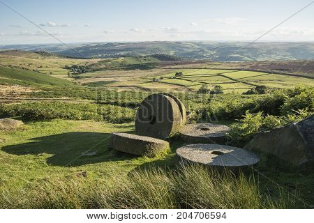 Summer Landscape Image Of Millstones On Top Of Stanage Edge In Peak District