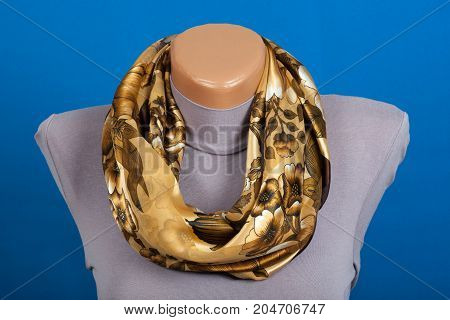 Beige Scarf On Mannequin Isolated On Blue Background