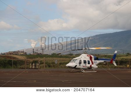 air ambulance on a landing pad by factory
