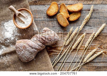 fresh tasty bread with wheat flour in bakery shop on wooden desk background top view