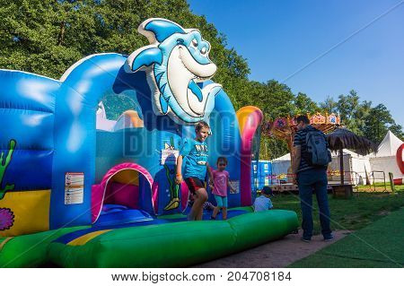 Front of a blue bounce house with sea theme on the Frajda Park in the summer season on August 2017 in Poznan Poland
