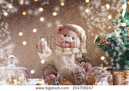 Festive background. Greeting card with copy space.Cute toy bear with santa hat. Christmas card. Winter background. christmas bear toy. Snow Falling Effect.