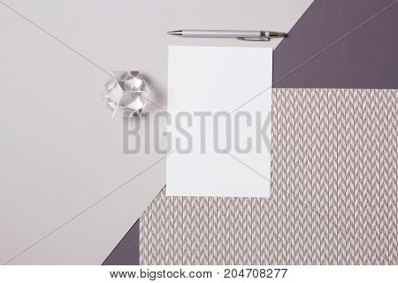 Business work day Workspace desk with notebook pencil on gray background. Business or work day background concept : Top view of workspace desk with blank notebook