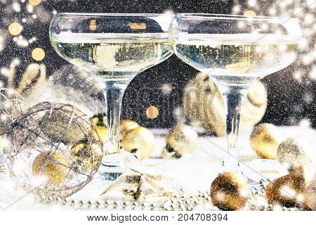 glasses of wine/ glasses of wine on the background of Christmas decorations. Christmas decorations with wineglass. Snow Falling Effect.