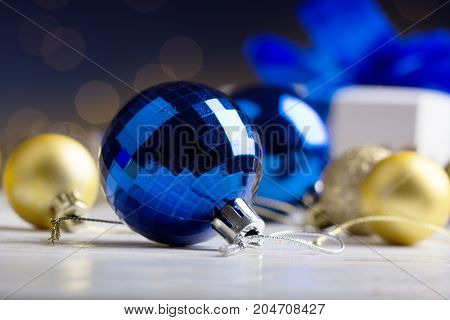 Christmas.Christmas blue balls snow and space abstract background. Christmas greeting card.