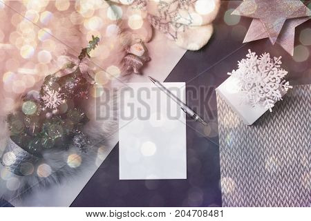 Holidays background. Blank paper Christmas card. copyspace of winter and Christmas concept. flat lay style. Christmas planning concept.